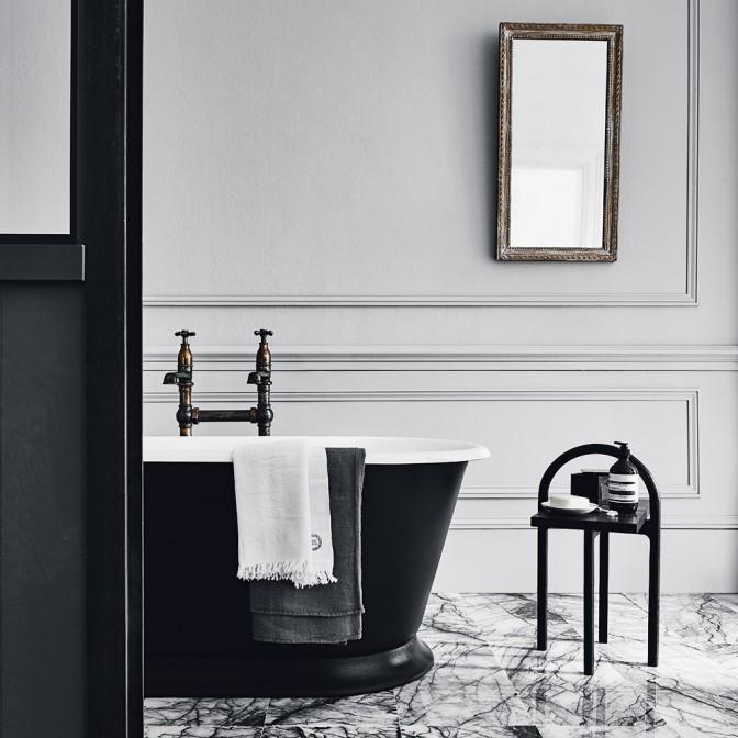 Classical bathroom with a smart black bath tub