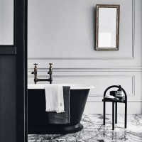 Classical bathroom with a smart black bath tub