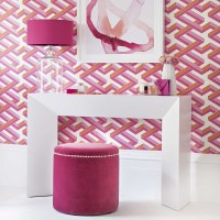 Pink and orange dressing room with white table and velvet stool