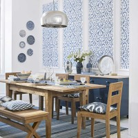 Mediterranean-chic dining room with distressed wood furniture