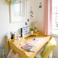 Creative study space in pastels and oak furniture