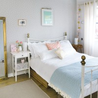 Pastel bedroom with brass bedstead and shabby chic furniture