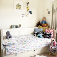 Stylish child's bedroom with light colours and smart storage