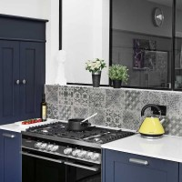 Heritage blue kitchen with encaustic tile splashback