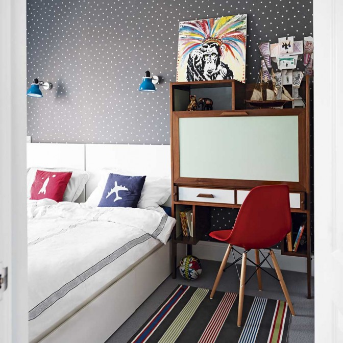 Boys bedroom with star-print wallpaper