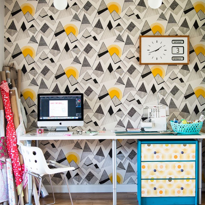 Artistic home office with geometric wallpaper