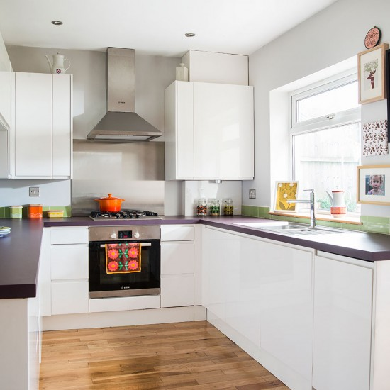 Modern Light Kitchen With Polished Wood Floor