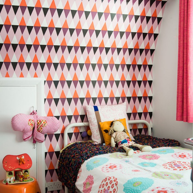 Bright children's bedroom with geometric wallpaper
