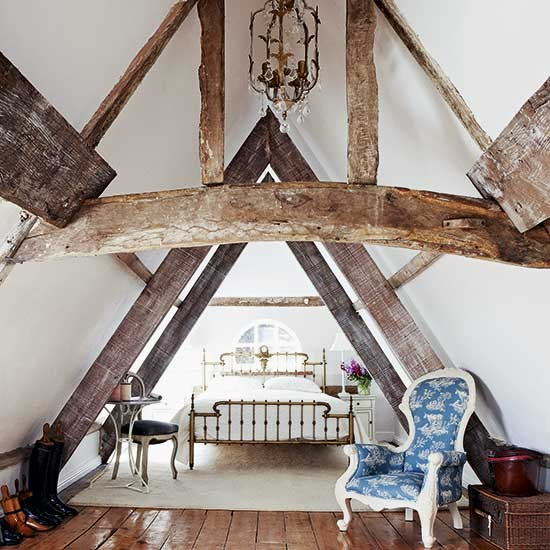attic ideas uk - Traditional attic bedroom with original exposed beams