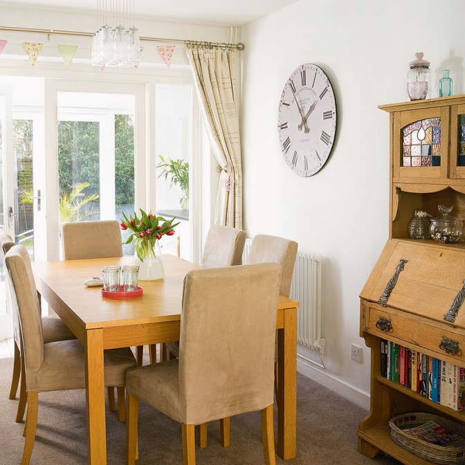 Light and open dining room leading to conservatory