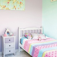 Traditional pink little girl's bedroom with white-painted furniture