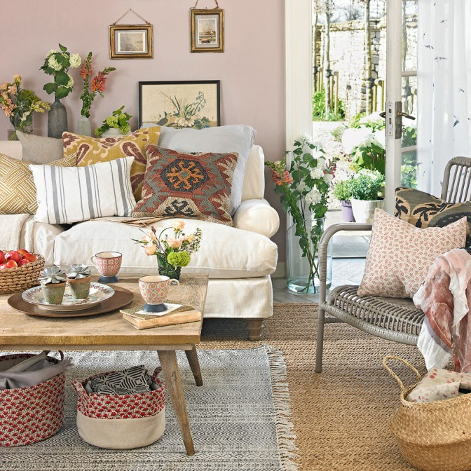 Pink country living room with ethnic accents