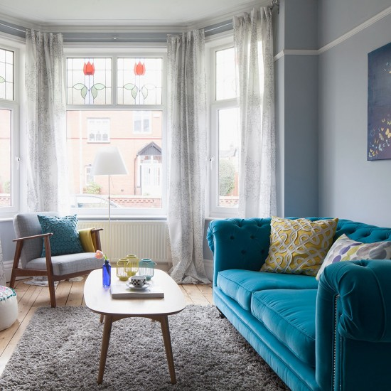 Period Living Room With Bold Blue Sofa