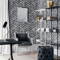 Monochrome home office with bold geometric wallpaper