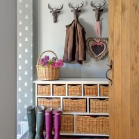 Country hallway with practical and decorative storage