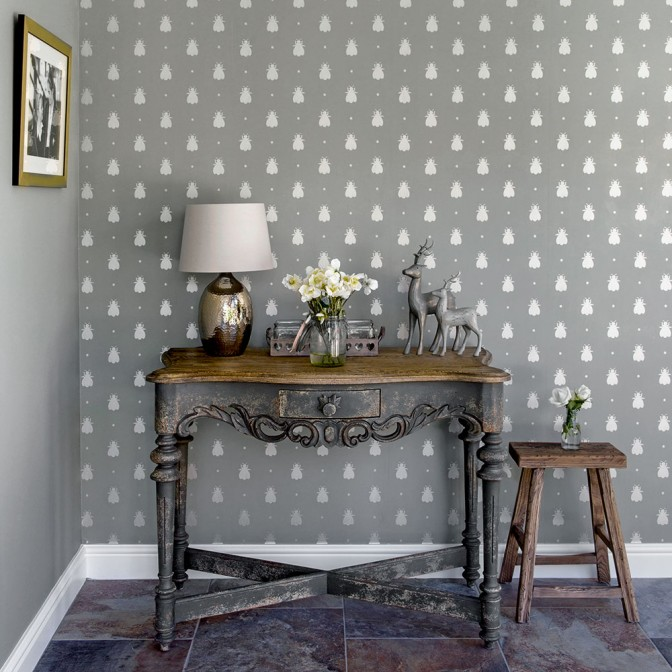 Country hallway with grey bee-patterned wallpaper