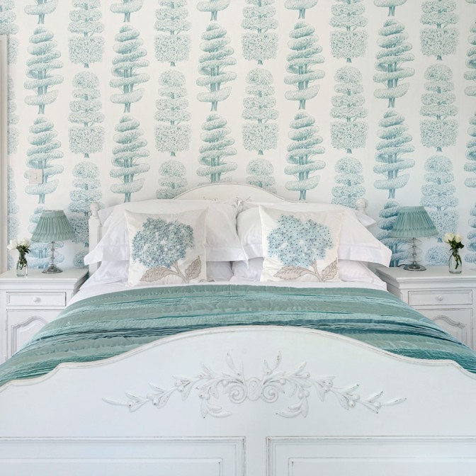 Classic country bedroom with nature-inspired wallpaper