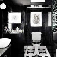 Stunning black cloakroom with chequerboard flooring