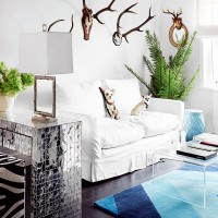 Eclectic white living room with mirrored console