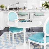 Modern white kitchen-diner with aqua blue chairs