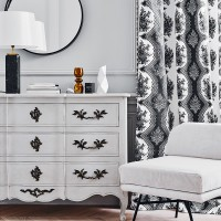 Monochrome bedroom with decorative chest of drawers