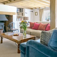 Country living room with wooden beams and inglenook