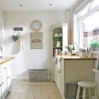 Kitchen corner with washing-up station overlooking garden