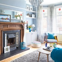 Blue light-filled living room with centrepiece fireplace
