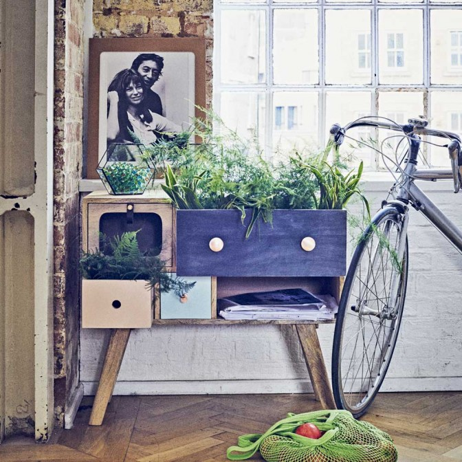 Botanical garden room with sideboard and wood flooring