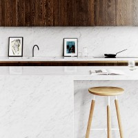 Contemporary kitchen with marble breakfast bar
