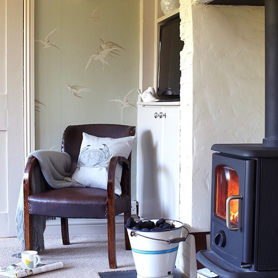 Paste up a panel of pretty bird wallpaper for a cosy corner