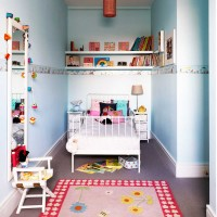 Child's pale blue bedroom with iron bed