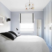 Pale grey bedroom with feature pendant lampshade