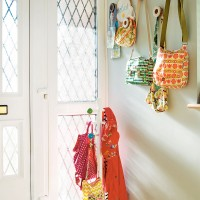 Bright hallway with colourful coat and bag hooks