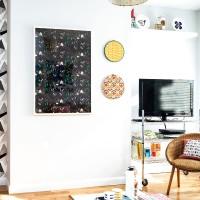White living room with framed prints