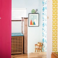 Hallway landing with colourful pictorial wallpaper