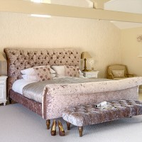 Country bedroom with velvet upholstered bed