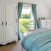 White country bedroom with duck-egg blue soft furnishings