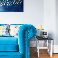 Turquoise Chesterfield sofa in neutral living room
