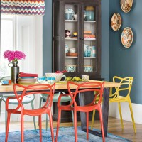 Dark blue dining room with contemporary chairs