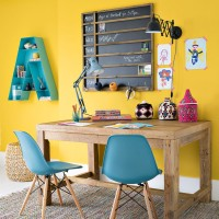 Yellow home office with modern blue chairs