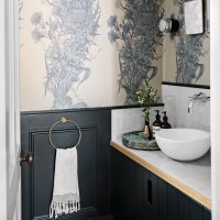 Chic cloakroom with feature wallpaper