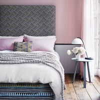 Elegant pink bedroom with geometric headboard