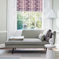 Understated living room with geometric Roman blind