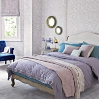 Lavender and lilac bedroom with patterned wallpaper