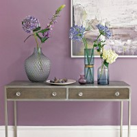 Dusty lavender hallway with glass vases and console table