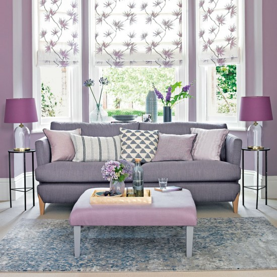 Lilac living room with grey toned sofa and floral blinds for Mauve living room ideas