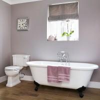Bathroom with classic roll-top bath and deep grey walls