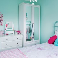 Girl's colourful room in bright aqua and pink