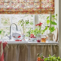 Country kitchen with pretty floral blind
